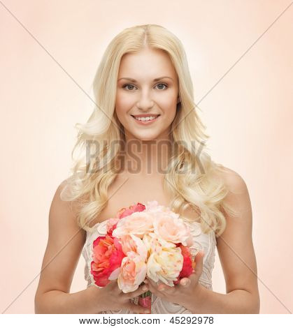 close up of young woman with bouquet of flowers