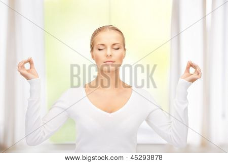 bright picture of woman in meditation at home
