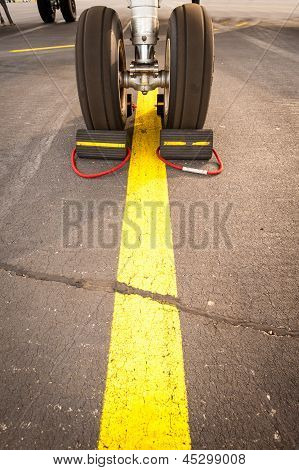 Airplane Tires On Yellow Line