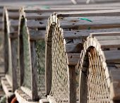 picture of lobster trap  - A row of lobster traps sits on a dock in Eastern Canada - JPG