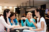 stock photo of adolescence  - group of young women on coffee break - JPG