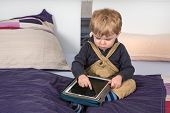 Little Toddler Boy Playing With Tablet Pc