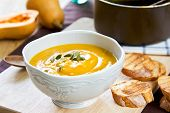 pic of butternut  - Butternut Squash Soup by loaf of bread - JPG
