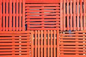 image of wooden pallet  - Abstract background of old wooden pallets made into an orange fence - JPG
