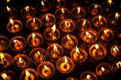 stock photo of himachal  - Burning candles in Tibetan Buddhist temple - JPG