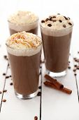 foto of cocoa beans  - Ice coffee with whipped cream and coffee beans on a white table - JPG