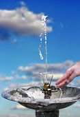 pic of gushing  - water gushing from a hose over blue sky - JPG