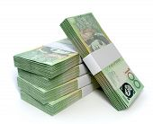 stock photo of oz  - A stack of bundled one hundred australian dollar notes on an isolated background - JPG