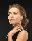 image of precious stone  - beautiful woman in evening dress wearing diamond earrings - JPG