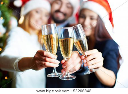 Three business partners toasting with champagne