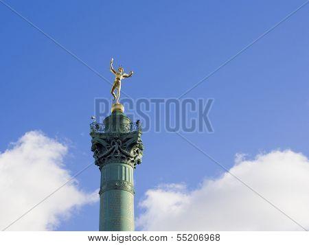 Gilded statue Genie de la Liberte at July Column Place de la Bastille Paris France