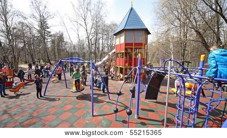 MOSCOW - MAY 1: Children with parents are playing on the playground in Sokolniki on May 1, 2013 in Moscow, Russia.