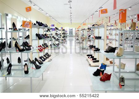 SAMARA, RUSSIA - JULY 7: Shelfs in shoes shop with inscriptions Sale and indicating shoe size in shopping complex Kosmoport, July 7, Samara. Complex includes more than one hundred boutiques and shops
