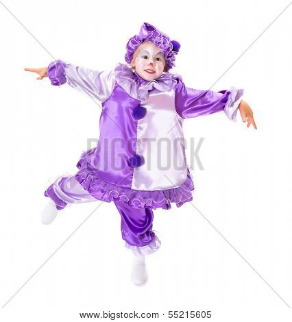 Adorable dancing girl in clown costume posing as a marionette without strings