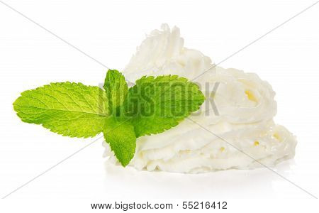 Whipped cream and spearmint leaves