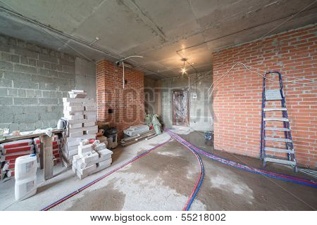 Room with universal gypsum plaster and others building materials in a newly built house