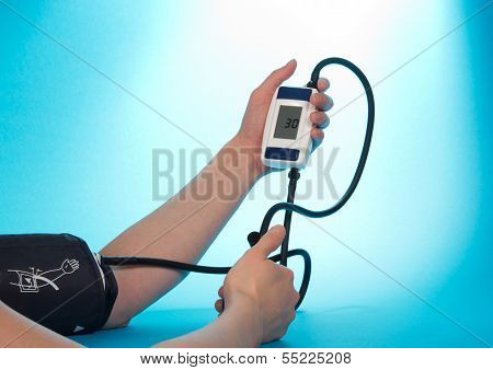 Person supervising blood pressure by tonometer