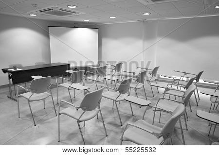 Classroom With School Chairs And Desk