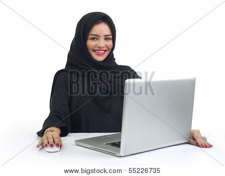 Beautiful Arabian business woman working on her laptop