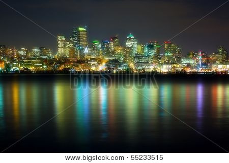 panorama of the city at night reflected in water, Seattle, USA