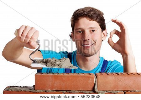 Happy Man Building A Wall