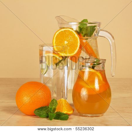 Jugs with drinks and glass
