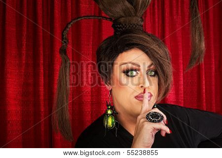 Man In Drag With Finger At Lips