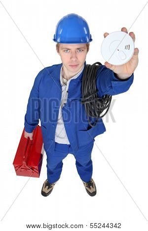 Electrician holding smoke alarm