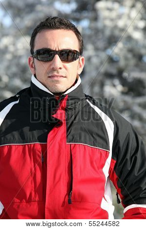 Man in a ski jacket and sunglasses