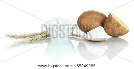 Starch in spoon with potatoes isolated on white