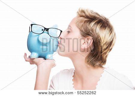 Woman Kissing A Piggy Bank