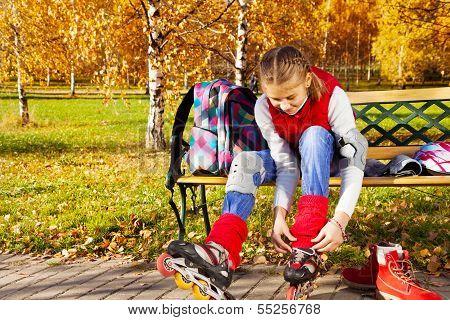 Girl Tie Shoelaces On Rollerblades
