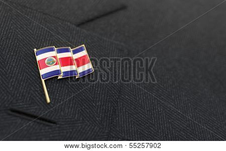 Costa Rica Flag Lapel Pin On The Collar Of A Business Suit