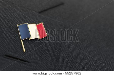 France Flag Lapel Pin On The Collar Of A Business Suit