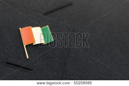 Ivory Coast Flag Lapel Pin On The Collar Of A Business Suit