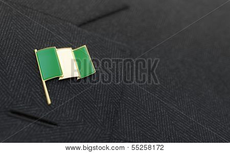 Nigeria Flag Lapel Pin On The Collar Of A Business Suit
