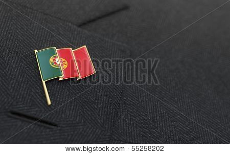 Portugal Flag Lapel Pin On The Collar Of A Business Suit