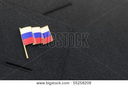 Russia Flag Lapel Pin On The Collar Of A Business Suit