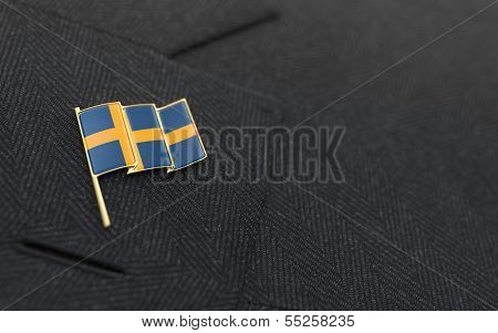 Sweden Flag Lapel Pin On The Collar Of A Business Suit