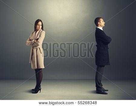 melancholy young woman looking back at the man