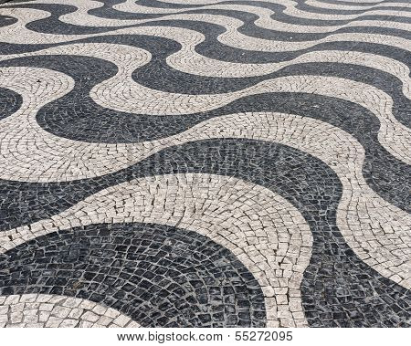 Detail of a typical portuguese cobblestone hand-made pavement.