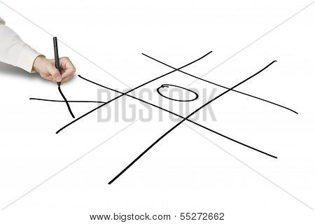 Man Hold Pen Drawing Tic-tac-toe Game On White