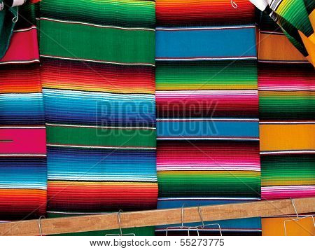 Hung colorful sarapes on mexican market