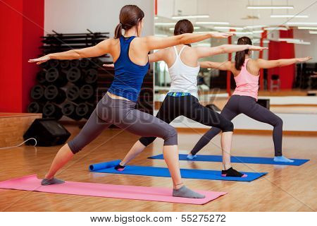 Warrior yoga pose by young women