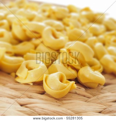 a pile of uncooked tortellini on a worktop