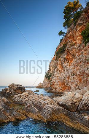 Red Coastal Rocks With Pine Trees. Adriatic Sea, Montenegro