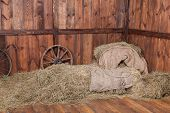 stock photo of hay bale  - Wood and hay background inside rural barn - JPG