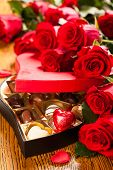 Heart shaped box of chocolate truffles with red roses