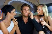 picture of cigar  - Happy young people having fun in luxury car - JPG