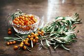 pic of sea-buckthorn  - sea buckthorn berries on a wooden table - JPG